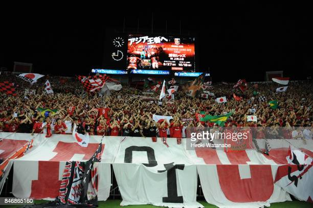 Fans of Urawa Red Diamonds cheer after the AFC Champions League quarter final second leg match between Urawa Red Diamonds and Kawasaki Frontale at...