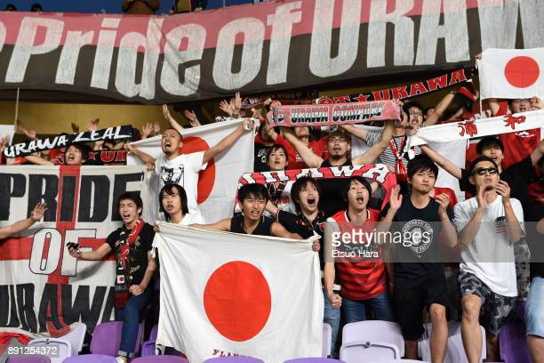 Fans of Urawa Red Diamonds cheer after the FIFA Club World Cup UAE 2017 Match for 5th Place between Wydad Casablanca and Urawa Reds at the Hazza Bin...