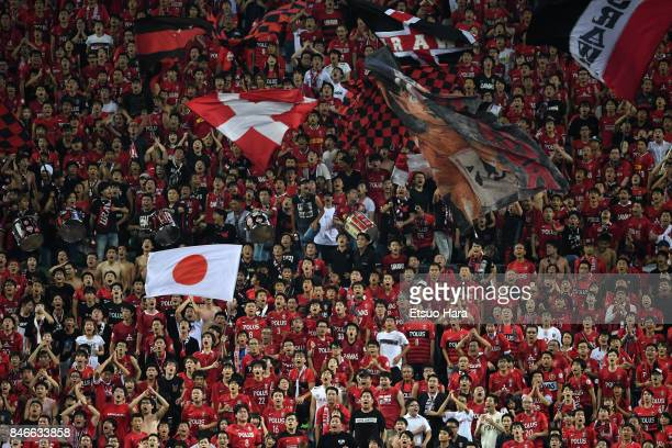 Fans of Urawa Red Diamonds cheer during the AFC Champions League quarter final second leg match between Urawa Red Diamonds and Kawasaki Frontale at...