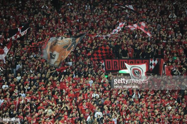 Fans of Urawa Red Diamonds cheer during the AFC Champions League semi final second leg match between Urawa Red Diamonds and Shanghai SIPG at Saitama...
