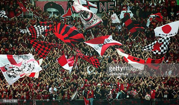 Fans of Urawa Red Diamonds cheer during the FIFA Club World Cup semi final match between Urawa Red Diamonds and AC Milan at the International Stadium...