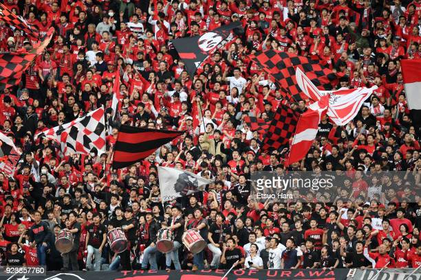 Fans of Urawa Red Diamonds cheer during the JLeague J1 match between FC Tokyo and Urawa Red Diamonds at Ajinomoto Stadium on February 24 2018 in...
