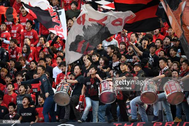 Fans of Urawa Red Diamonds cheer during the JLeague J1 match between FC Tokyo and Urawa Red Diamonds at Ajinomoto Stadium on February 24 2018 in...