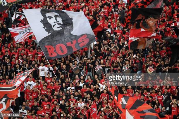 Fans of Urawa Red Diamonds cheer during the JLeague J1 match between Urawa Red Diamonds and Sanfrecce Hiroshima at Saitama Stadium on March 4 2018 in...