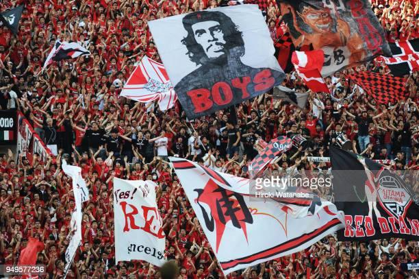 Fans of Urawa Red Diamonds cheer during the JLeague J1 match between Urawa Red Diamonds and Consadole Sapporo at Saitama Stadium on April 21 2018 in...
