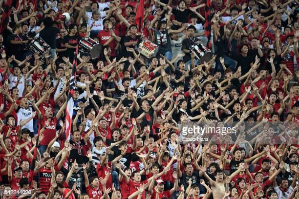 Fans of Urawa Red Diamonds cheer during the JLeague Levain Cup quarter final second leg match between Urawa Red Diamonds ant Cerezo Osaka at Saitama...
