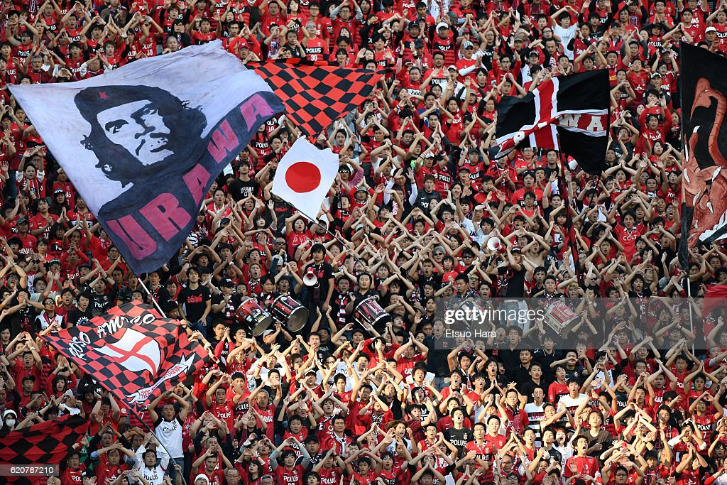 Fans of Urawa Red Diamonds cheer during the J.League match between Urawa Red Diamonds and Yokohama F.Marinos at Saitama Stadium on November 3, 2016 in Saitama, Japan.