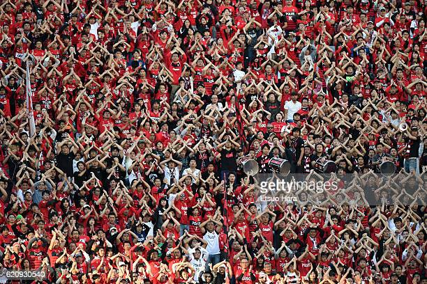 Fans of Urawa Red Diamonds cheer during the JLeague match between Urawa Red Diamonds and Yokohama FMarinos at Saitama Stadium on November 3 2016 in...