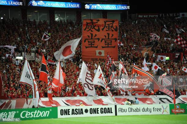 Fans of Urawa Red Diamonds cheer prior to the AFC Champions League quarter final second leg match between Urawa Red Diamonds and Kawasaki Frontale at...