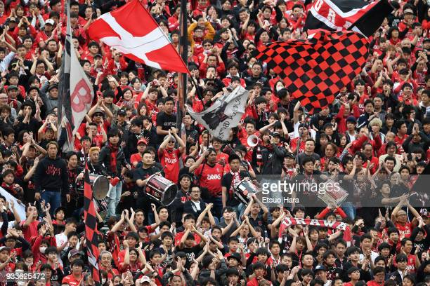 Fans of Urawa Red Diamonds cheer prior to the JLeague J1 match between Urawa Red Diamonds and Yokohama FMarinos at Saitama Stadium on March 18 2018...