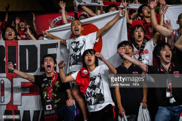 Fans of Urawa Reds enjoy the atmosphere during the FIFA Club World Cup UAE 2017 fifth place playoff match between Wydad Casablanca and Urawa Reds on...