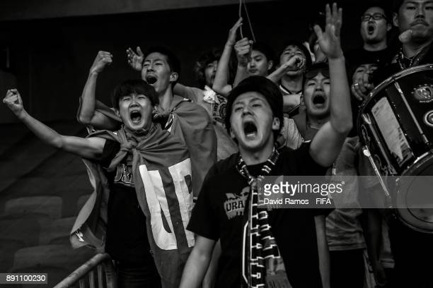 Fans of Urawa Reds enjoy the atmosphere during the FIFA Club World Cup UAE 2017 fifth place playoff match between Wydad Casablanca and Urawa Reds at...