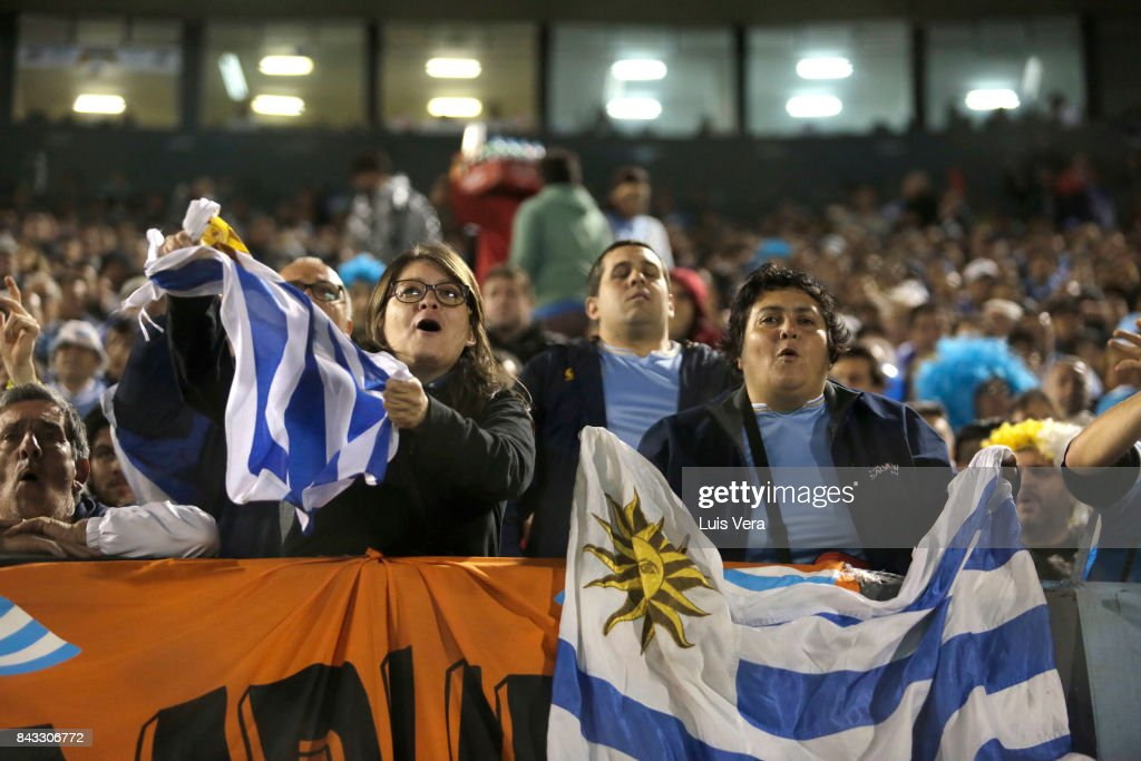 Fans of Uruguay cheer for their team during a match between Paraguay and Uruguay as part of FIFA 2018 World Cup Qualifiers at Defensores del Chaco Stadium on September 05, 2017 in Asuncion, Paraguay.