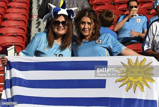 Fans of Uruguay displays the Uruguay's flag prior to the start of the 2016 Copa America Centenario Group match play between Uruguay and Jamaica at...