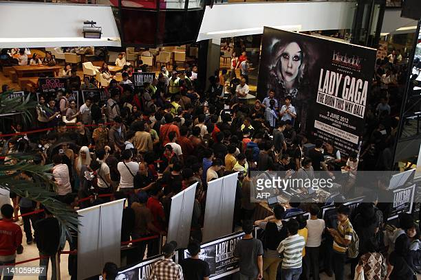 Fans of US pop diva Lady Gaga queue for concert tickets in Jakarta on March 10, 2012. Western performers are finding a bigger audience in Indonesia's...