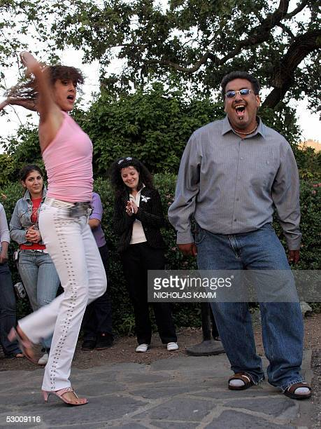 Fans of US pop star Michael Jackson dance to a tune of their idol after holding a prayer vigil, 01 June 2005, in front of his Neverland ranch in Los...