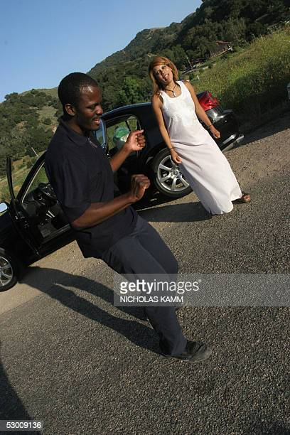 Fans of US pop star Michael Jackson dance to a tune of their idol before holding a prayer vigil, 01 June 2005, in front of his Neverland ranch in Los...