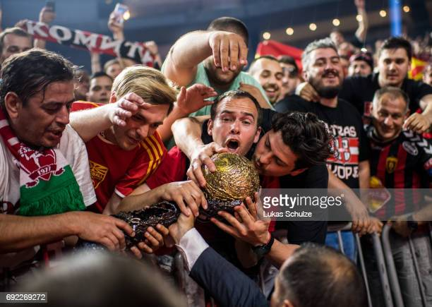 Fans of Vardar touch with the trophy after winning the VELUX EHF FINAL4 Final match between Paris SaintGermain Handball and HC Vardar at Lanxess...