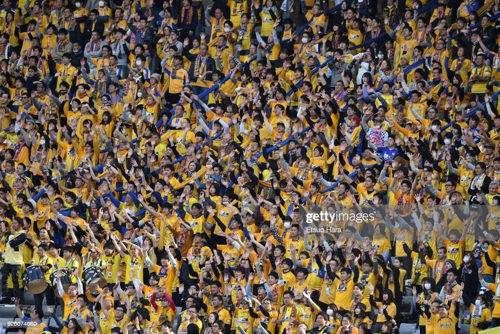 Fans of Vegalta Sendai cheer during the J.League J1 match between FC Tokyo and Vegalta Sendai at Ajinomoto Stadium on March 3, 2018 in Chofu, Tokyo, Japan.
