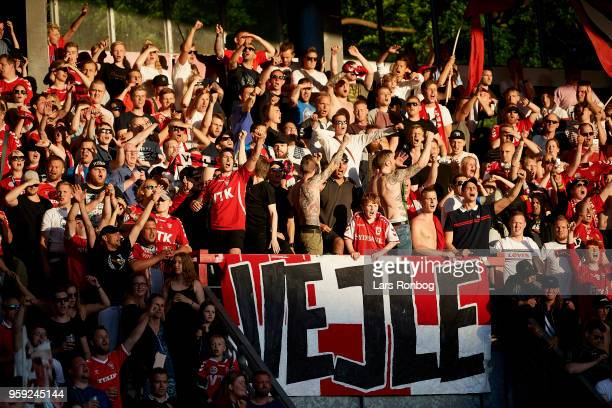 Fans of Vejle Boldklub celebrate after the Danish NordicBet Liga match between Vejle Boldklub and FC Fredericia at Vejle Stadion on May 16 2018 in...