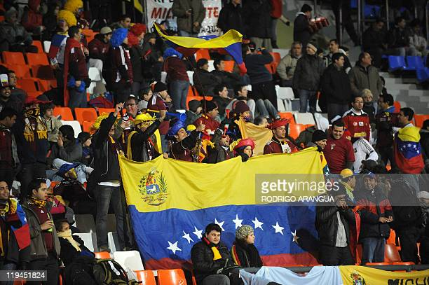 Fans of Venezuela cheer for their team before the start of their 2011 Copa America semifinal football match against Paraguay held at the Malvinas...