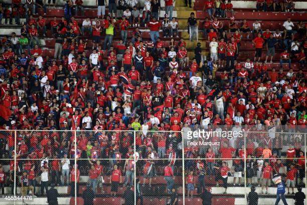 Fans of Veracruz cheer for their team during a match between Veracruz and Atlas as part of 8th round Apertura 2014 Liga MX at Luis 'Pirata' Fuente...