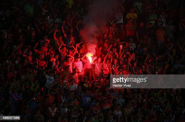 Fans of Veracruz light a flare during the 16th round match between Veracruz and Tigres UANL as part of the Apertura 2015 Liga MX at Luis Pirata de la...