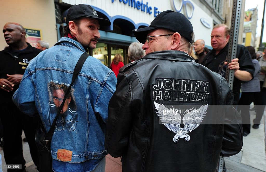Fans of veteran French rocker Johnny Hallyday await entry into the Orpheum Theater for his first concert in two years on April 24, 2012 in Los Angeles, California, where Hallyday begins a comeback tour two years after a health scare which nearly killed him in his adopted home of Los Angeles. In a tribute to the city 'where they saved my life,' the 68-year-old will start the more than 50-show tour aiming to 'make the public tremble with emotion,' he told AFP earlier this month. AFP PHOTO/Frederic J. BROWN