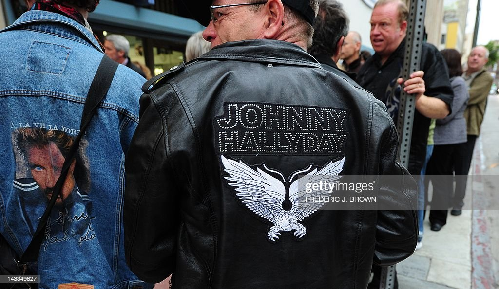 Fans of veteran French rocker Johnny Hallyday display their attire while awaiting entry into the Orpheum Theatre for his first concert in two years on April 24, 2012 in Los Angeles, California, where Hallyday begins a comeback tour two years after a health scare which nearly killed him in his adopted home of Los Angeles. In a tribute to the city 'where they saved my life,' the 68-year-old will start the more than 50-show tour aiming to 'make the public tremble with emotion,' he told AFP earlier this month. AFP PHOTO/Frederic J. BROWN