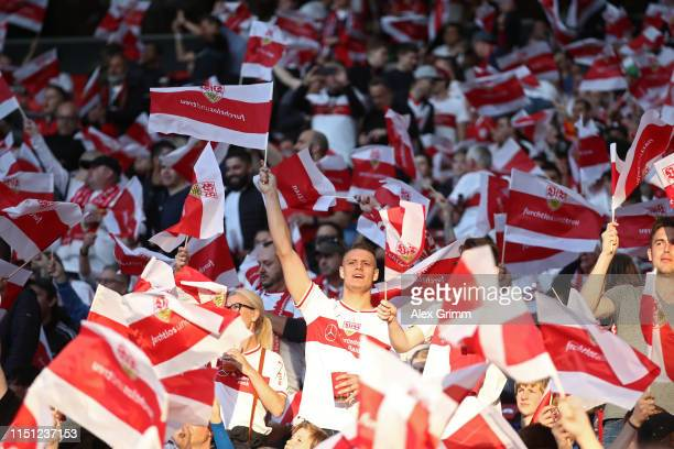 Fans of VfB Stuttgart cheer prior the Bundesliga playoff first leg match between VfB Stuttgart and 1. FC Union Berlin at Mercedes-Benz Arena on May...