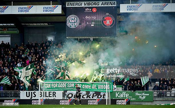 Fans of Viborg FF celebrate and cheer with pyrotechnics during the Danish Alka Superliga match between Viborg FF and FC Midtjylland at Energi Viborg...