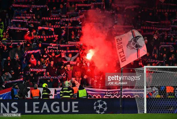 Fans of Viktoria Plzen light flares after the UEFA Champions League group G football match between FC Victoria Plzen and AS Roma in Plzen, on...