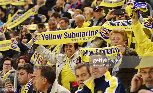 Fans of Villarreal hold up scarves with Yellow Submarine printed on them to show respect to the 96 Liverpool fans who lost their lives at the...