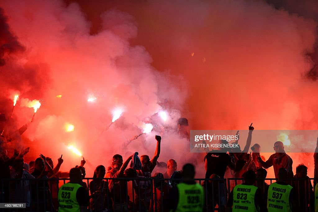 Fans of VTK Diosgyor light flares after scoring during the Hungarian Cup final football match VTK Disosgyor vs TE Ujpest on May 25, 2014 at the Puskas stadium in Budapest.