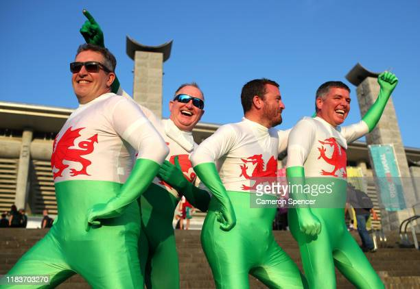 Fans of Wales pose for a photo outside the stadium prior to the Rugby World Cup 2019 SemiFinal match between Wales and South Africa at International...
