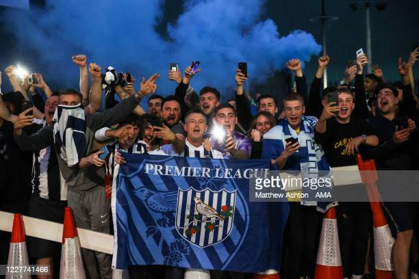 Fans of West Bromwich Albion celebrate promotion outside the stadium during the Sky Bet Championship match between West Bromwich Albion and Queens...