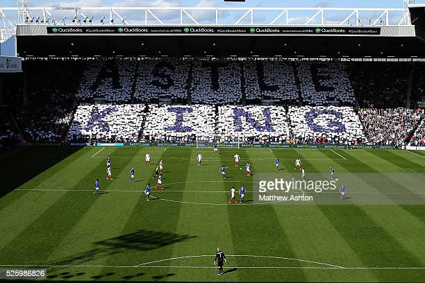 Fans of West Bromwich Albion hold up a mosaic saying ASTLE KING in the Birmingham Road End of The Hawthorns Stadium on Jeff Astle Day celebrating the...