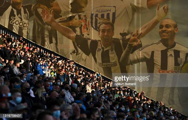 Fans of West Bromwich Albion look on from the stands during the Premier League match between West Bromwich Albion and West Ham United at The...