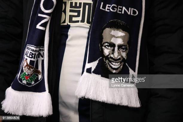 Fans of West Bromwich Albion pay tribute to Cyrille Regis during the Premier League match between West Bromwich Albion and Southampton at The...