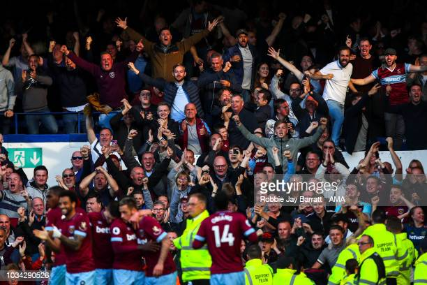 Fans of West Ham United celebrate after Marko Arnautovic of West Ham United scores a goal to make it 13 during the Premier League match between...