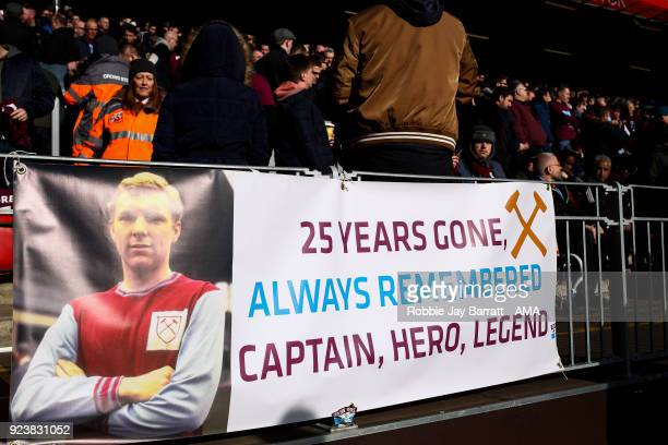 Fans of West Ham United put up a banner in respect of the 25 year anniversary death of Bobby Moore during the Premier League match between Liverpool...