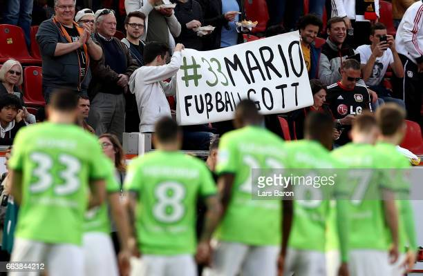 Fans of Wolfsburg hold a banner for Mario Gomez during the Bundesliga match between Bayer 04 Leverkusen and VfL Wolfsburg at BayArena on April 2 2017...