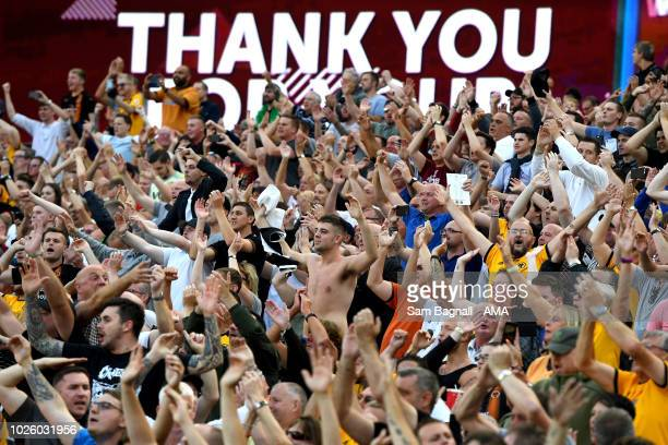 Fans of Wolverhampton Wanderers celebrate at full time during the Premier League match between West Ham United and Wolverhampton Wanderers at London...