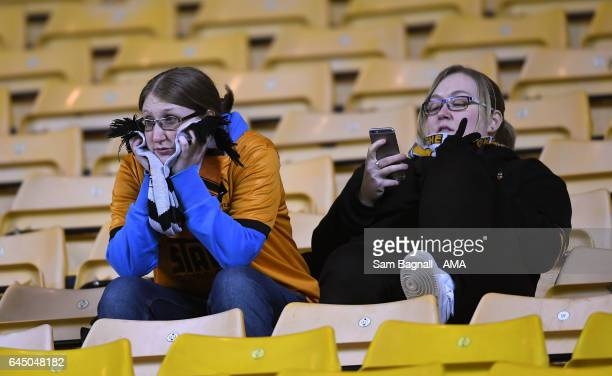 Fans of Wolverhampton Wanderers cry at full time during the Sky Bet Championship match between Wolverhampton Wanderers and Birmingham City at...