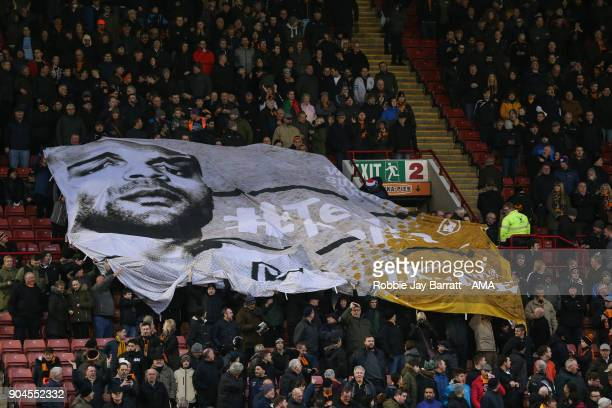 Fans of Wolverhampton Wanderers hold up a banner for Carl Ikeme of Wolverhampton Wanderers during the Sky Bet Championship match between Barnsley and...