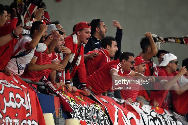 Fans of Wydad Casablanca cheer during the FIFA Club World Cup UAE 2017 Match for 5th Place between Wydad Casablanca and Urawa Reds at the Hazza Bin...