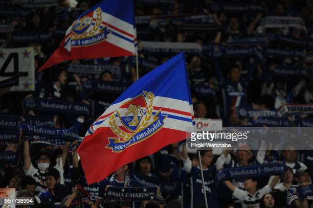 Fans of Yokohama FMarinos cheer during the JLeague J1 match between Yokohama FMarinos and Gamba Osaka at Nissan Stadium on May 12 2018 in Yokohama...