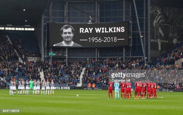 Fans officials and players take part in a minute of applause for Ray Wilkins who passed away earlier in the week an image of Cyril Regis who passed...