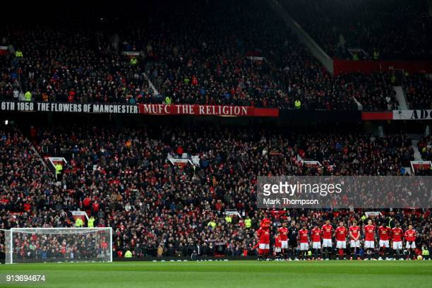 Fans officials and players take part in a minute silence in tribute to the Manchester United players involved in the Munich disaster ahead of the...
