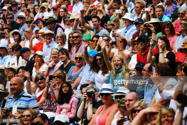 Fans on centre court before the start of the Novak Djokovic of Serbia and Roger Federer of Switzerland Gentlemen's Singles Final match on day...